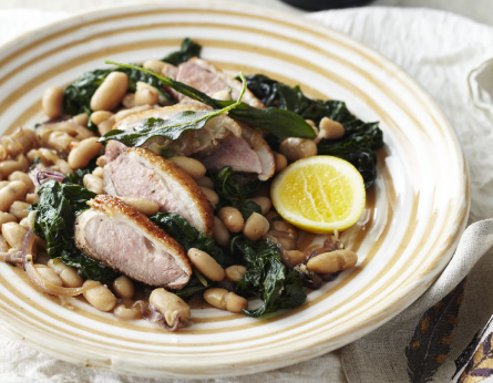 Duck breast with white beans, baby spinach and sage
